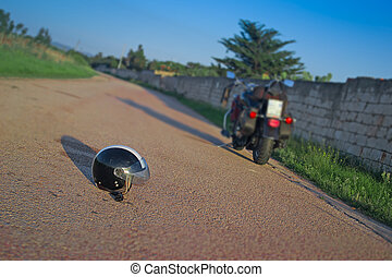 helmet and motorcycle in an empty road at dusk