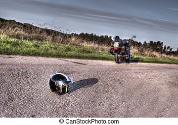 motorcycle and helmet - helmet and motorcycle in an empty...