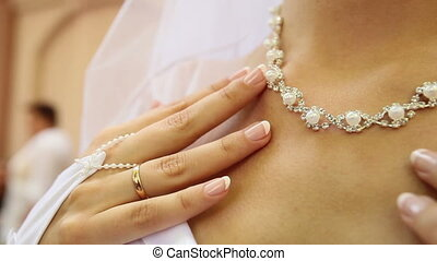 bridal pearl necklace - bride breathes lay her hand with a...