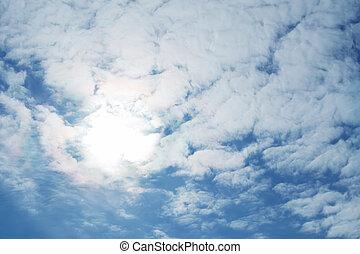 sun through clouds - bright sun through fluffy clouds