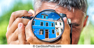 Photographer taking photo with DSLR camera at Burano...