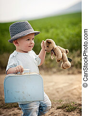 Little boy playing in nature - Little boy playing with teddy...