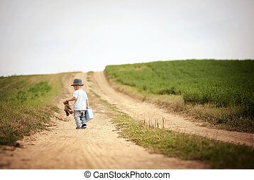 Little boy walking in nature - Rear view of little boy...