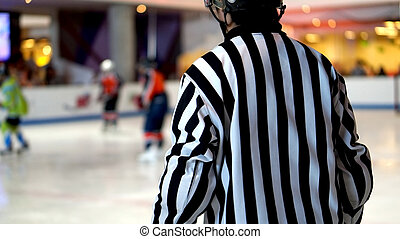 referee in ice hocky game abstract