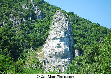 Mountain Sculpture at Mraconia Romania representing...