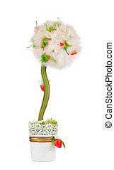 Artificial flower in a pot.