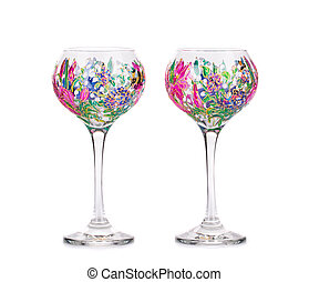 Two wine glasses with acrylic drawings Isolated on a white...