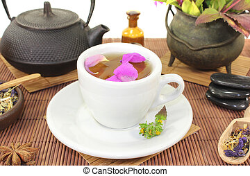 Chinese natural medicine with a cup of tea and stones -...