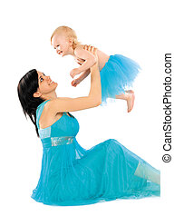 Mom and daughter in a beautiful blue dresses happily spend...