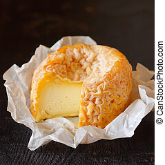 Cheese. - French cheese Langres on an old wooden background.