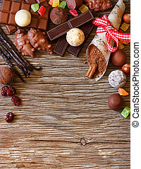 Chocolates. - Delicious chocolates and spices on a white...