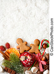 Christmas - Christmas sweets on snow with copy space for...