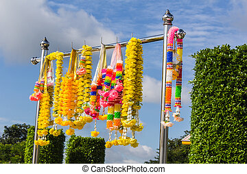 Colorful artificial garland for place of worship