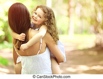 Joyful child and mother having fun, friendly family walks...