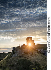Beautiful Summer sunrise over landscape of medieval castle...