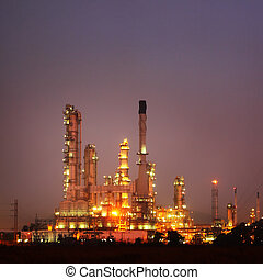 Petrochemical oil refinery plant at twilight. -...