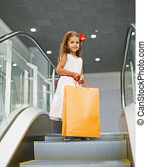 Little girl with shopping bag