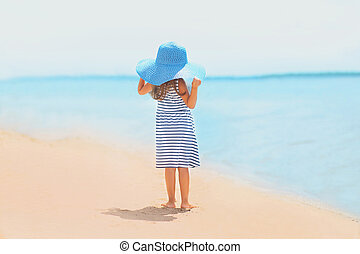 Summer travel photo pretty girl in dress and hat enjoying on the