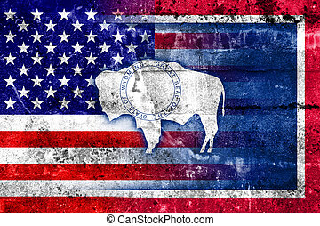 USA and Wyoming State Flag painted on grunge wall