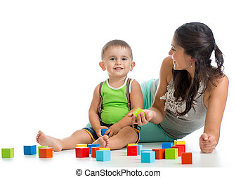 kid boy and mother playing together with construction set toy