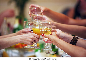 toast - Hands holding wedding glasses with drinks