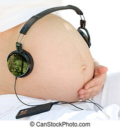 Listening to a music - Headphones on a pregnant womans...