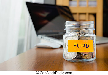 Investment fund saving plan - Glass bank with many world...