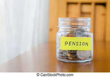Pension and retirement income - Glass bank with many world...