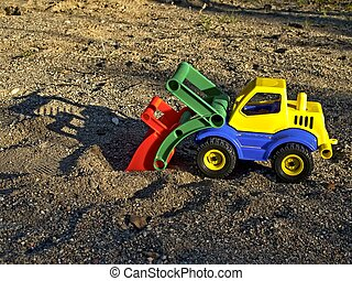 Toy vehicle - Plastic toy vehicle in sand box at childrens...