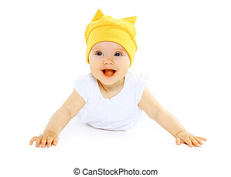 Happy smiling baby in yellow hat