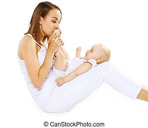 Mom kissing feet baby
