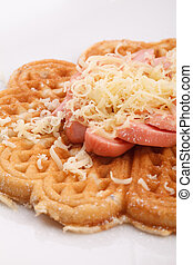 waffle with sauce - waffle with sausace topping with shred...