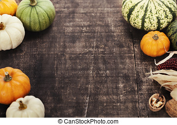 Autumn frame from pumpkins and corn on old wooden table...
