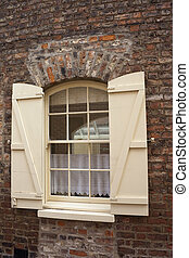 open shutters - cream coloured wooden shutters open to...
