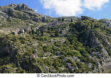 Medieval citadel in the mountains Kotor, Montenegro -...
