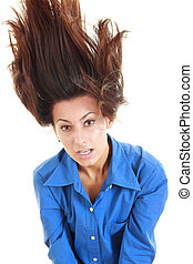 Surprised woman tossing long brunette hair in the air