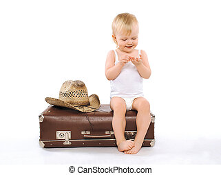 Child sits suitcase counts money on tours, travel, vacation...