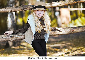 Portrait fashionable teen girl, blonde Country, rustic,...