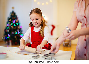 Family baking on Christmas eve - Family of mother and...