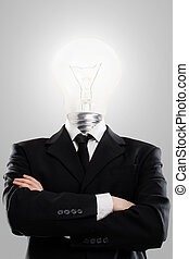 Businessman with lamp instead head
