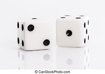Rolling dice over a white background