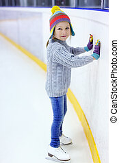 Little girl ice skating - Adorable little girl wearing...