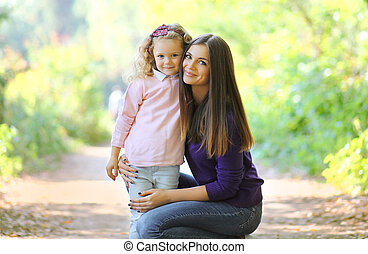 Lovely mom and child in sunny day