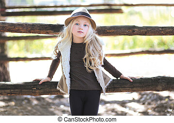 Fashionable teen girl, blonde Country, rustic, ranch - style...