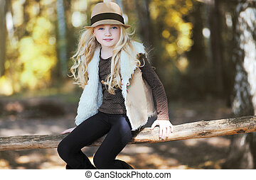 Stylish teen girl, blonde Country, rustic, ranch - style