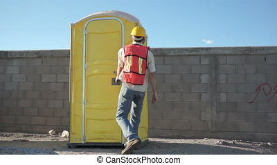 Male Worker Portable Bathroom - Male construction worker in...