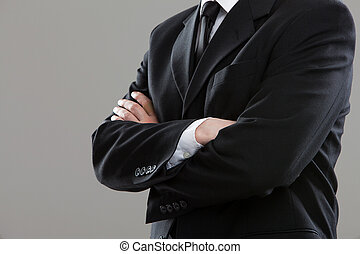 Businessmans torso in suit over grey background