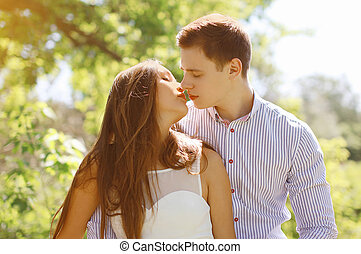 Sensual kiss young couple in summer day
