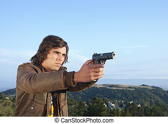 young man with semi-automatic pistol drawn