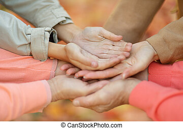 Hands together against leaves - Hands together against the...